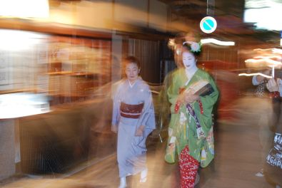 A geisha walking from teahouse to teahouse in the Gion area.