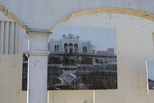 Photo of the Presidential palace hanging on its ruins. The palace was destroyed in a massive earthquake
