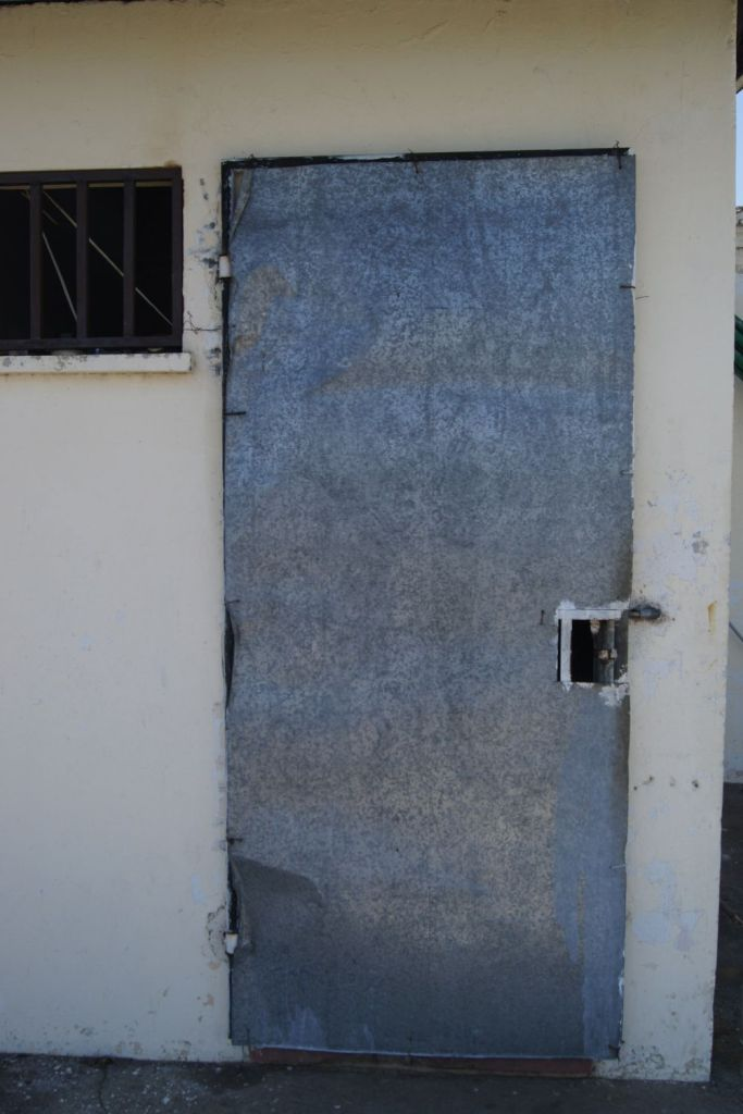 The site was used as a prison where current President Daniel Ortega and many other political prisoners were tortured during the Somoza regime. This here is a door leading into one of the prison cells