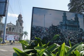 Plaza de la Revolución with a picture of how it looked during the revolution